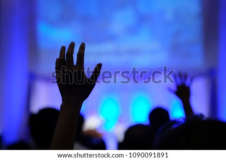 blurred, silhouette hands raising for religion background #1090091891