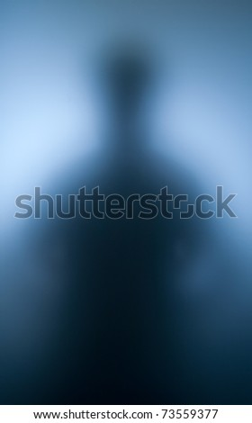 Blurred silhouette of human spirit against light - stock photo