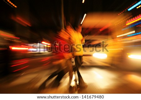Blurred silhouettes of people in city