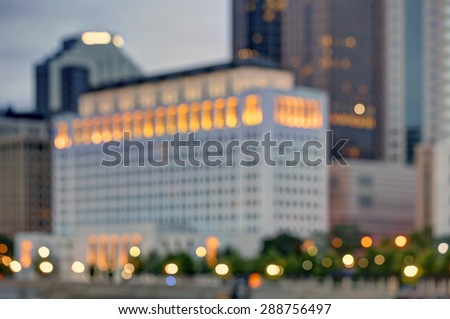 Blurred skyline at dusk with vibrant colors and interesting shapes