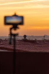 Blurred smartphone recording fantastic sunset time-lapse