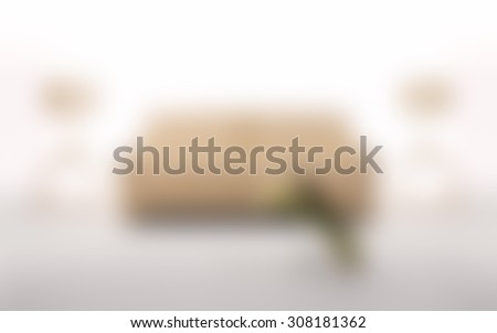 Blurred sofa in a living room/sitting room background.