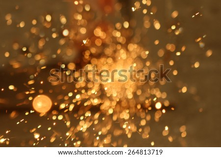Blurred sparks from grinding steel. #264813719