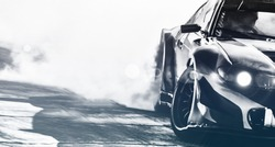 Blurred sport car drifting on speed track. Sport car wheel drifting and smoking with flare effect on track. Sport concept,drifting car concept.
