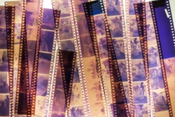 Blurred stack of old films on the light background.