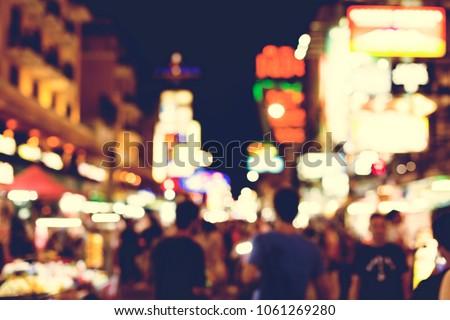 Blurred street market lights at night time