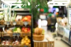Blurred Supermarket Aisle Background, Blurry Shot Of Vegetables And Fruits Department In Store. Grocery Shopping Concept. Abstract Image Of Shop With Defocused Unrecognizable Customers