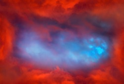 Blurred Swirl in the Red Clouds with a Light