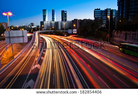 Blurred Tail Lights And Traffic Lights On Motorway #182854406