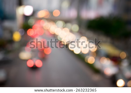 Blurred traffic lights in twilight time , blurred background