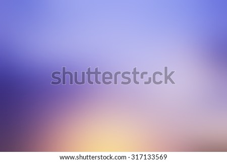 blurred twilight sky backgrounds: blur of beautiful natural sky in sunset time: blurred colorful of purple,yellow pattern with shiny light:blur backgrounds concept.pastel tone styles.