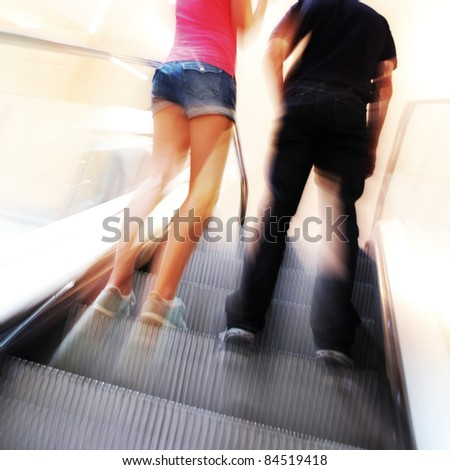 blurred unrecognizable people in motion in a shopping mall
