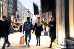 Blurred upmarket shopping street scene