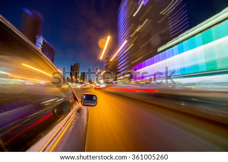 blurred urban look of the car movement nights longexposure #361005260