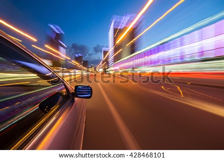 blurred urban look of the car movement nights longexposure #428468101