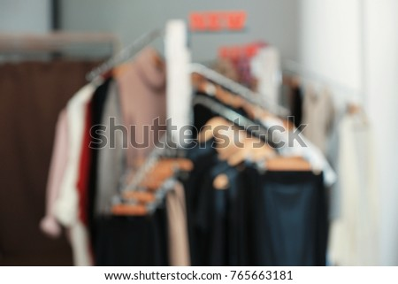 Blurred view of clothes rack in boutique #765663181