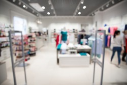 Blurred view of clothing store with canner entrance gate for prevent theft