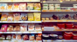 blurred view of frozen foods on the refridgerator in convenient mart. frozen foods product for city lifestyle.