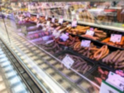 Blurred view of interior of large food shopping center