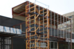 Blurred view of new building exterior with scaffolding