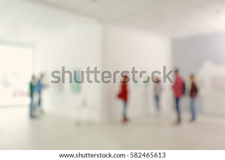 blurred view of people in...