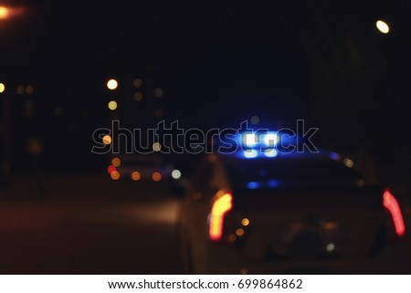 blurred view of police car on...