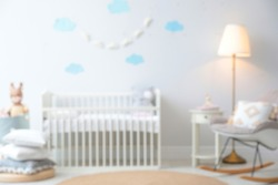 Blurred view of stylish baby room interior