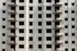 Blurred view of unfinished building as background