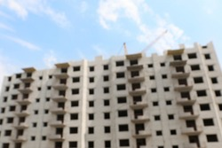 Blurred view of unfinished white building outdoors