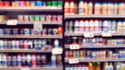blurred view of variety brands of fermented milk display in refridgerator in convenient store or mini mart.