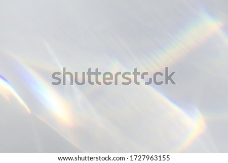 Blurred water texture overlay effect for photo and mockups. Organic drop diagonal shadow and light caustic effect on a white wall. Shadows for natural light effects stock photo