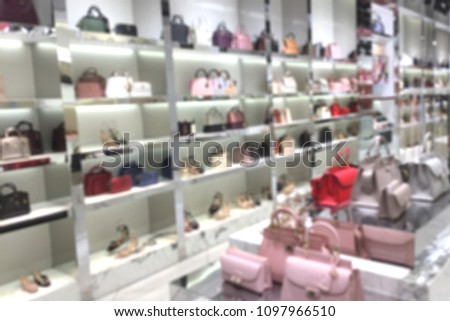 Blurred woman fashionable accessory and bag brandname shop on department store