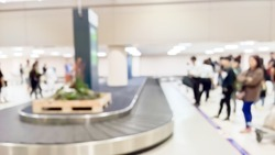 Blurry abstract background of travellers waiting for luggage - Conveyer belt - Airport