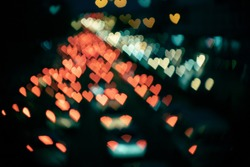 Blurry abstract heart-shaped bokeh from cars in film look