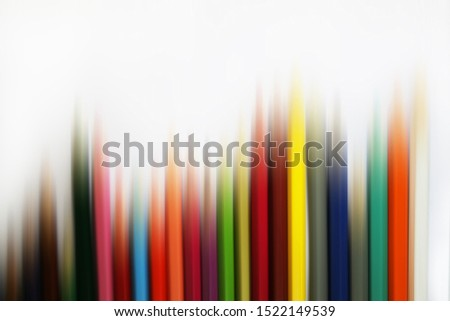 Blurry abstract of colored pencils isolated on white background. Pencil stripes colorful backgrounds. Digital motion effect in tropical colors. Copy space for text or design.