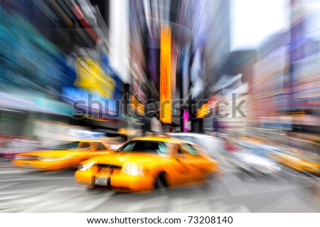 Blurry abstract photo of yellow taxi cabs in Times Square in Manhattan, New York in motion.