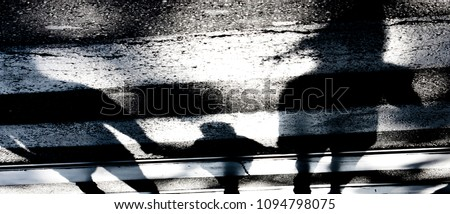 Blurry abstract shadow silhouette of family with a child on crossroads in black and white