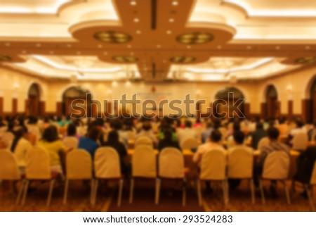 blurry auditorium meeting room