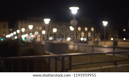 Stock Photo Blurry backdrop of bridge in Florence, Italy with bokeh streetlights at night