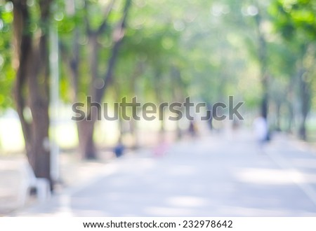 Blurry background, Blur street, road in nature outdoor with bokeh light background, Blurry people running on street, road at green tree park garden nature in spring and summer backdrop, banner, poster