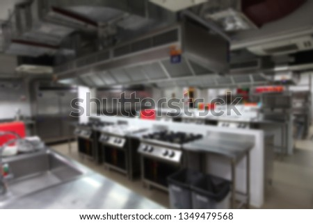 blurry background of kitchen with cooking equipment, Nobody inside.