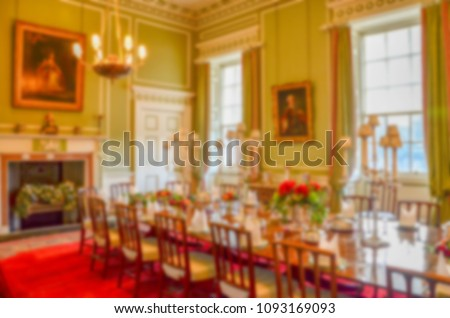 Blurry background texture. Defocused view of luxurious dinning room with traditional Euopean style interior. Concept of luxury, noble, upper class and warm atmosphere.