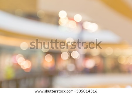 Blurry bokeh light in shopping mall for business blurry background