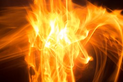 Blurry bonfire flame. Hellfire. Explotion from within.