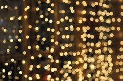 Blurry Christmas lights festive background. Use this unique blurred lights pic in the graphic design or illustration.