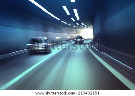 Blurry chromatic color tunnel car traffic motion blur. #219432151