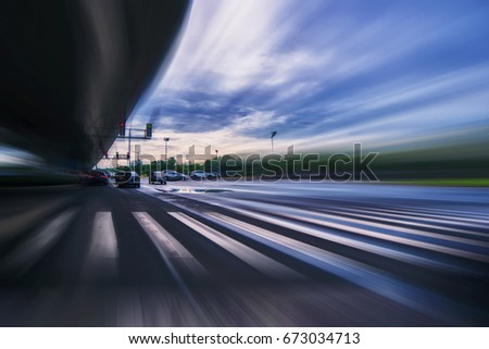 Blurry chromatic color tunnel car traffic motion blur. Motion blur  the speed and dynamics. #673034713