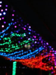 Blurry Colorful lamps that glow in the dark. Bokeh lamps. Party lights, defocused