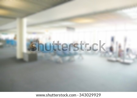 blurry defocused image of people at the airport terminal building