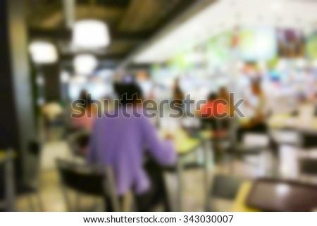 blurry defocused image of people eating food in food court in department store #343030007